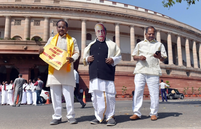 TDP party leaders, wearing a mask of former Deputy Prime Minister late Sardar Vallabhbhai Patel, during a protest demanding a special status for Andhra Pradesh during Budget Session at Parliament House in New Delhi.