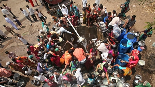 File photo of villagers in Jalna, Maharashtra scrambling for water as a tanker pours water into their well