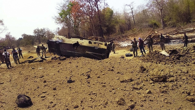 Security personnel inspect the site of an IED blast where nine CRPF personnel were killed and two more were injured after Maoists ambushed them in Kistaram area of Chhattisgarh's Sukma district.