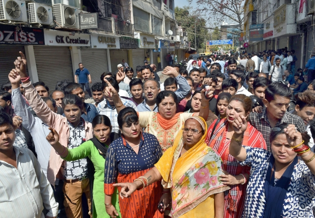 Traders of shops at Amar Colony protest against sealing drive in New Delhi.