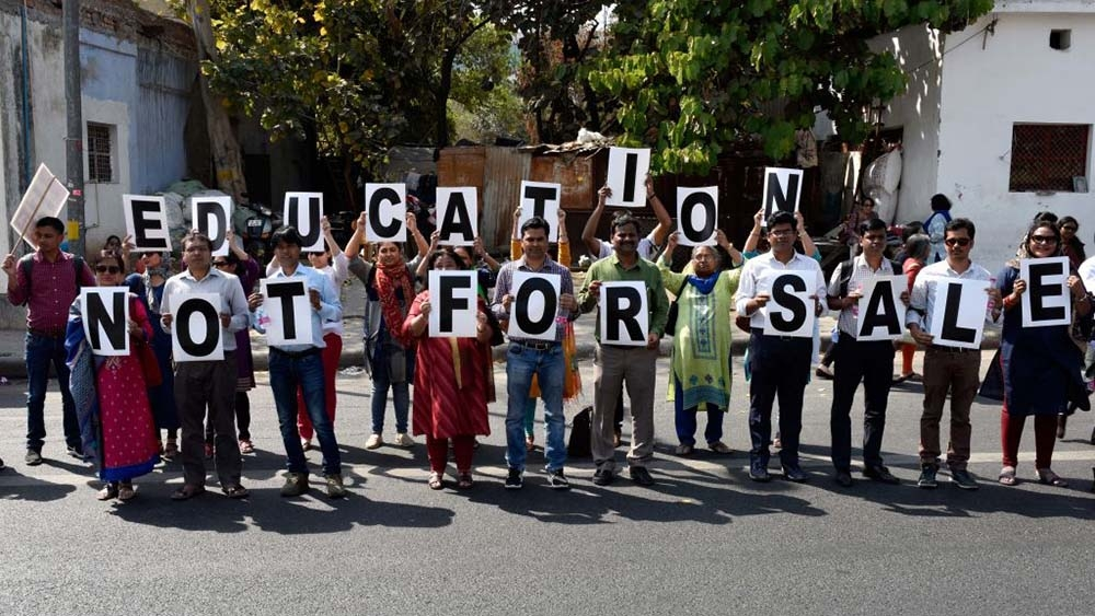 File photo of members of Delhi University Teachers Associations protesting near the UGC building at ITO in New Delhi