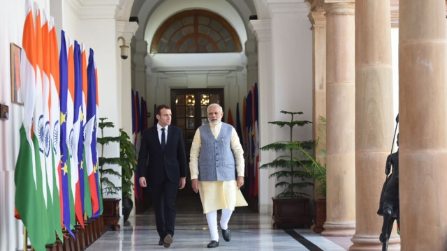 French President Emmanuel Macron and Indian Prime Minister Narendra Modi ahead of the joint press briefing in New Delhi's Hyderabad House on Saturday