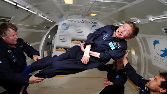 File photo of noted physicist Stephen Hawking (center) experiencing zero gravity during a flight aboard a modified Boeing 727 aircraft owned by Zero Gravity Corp