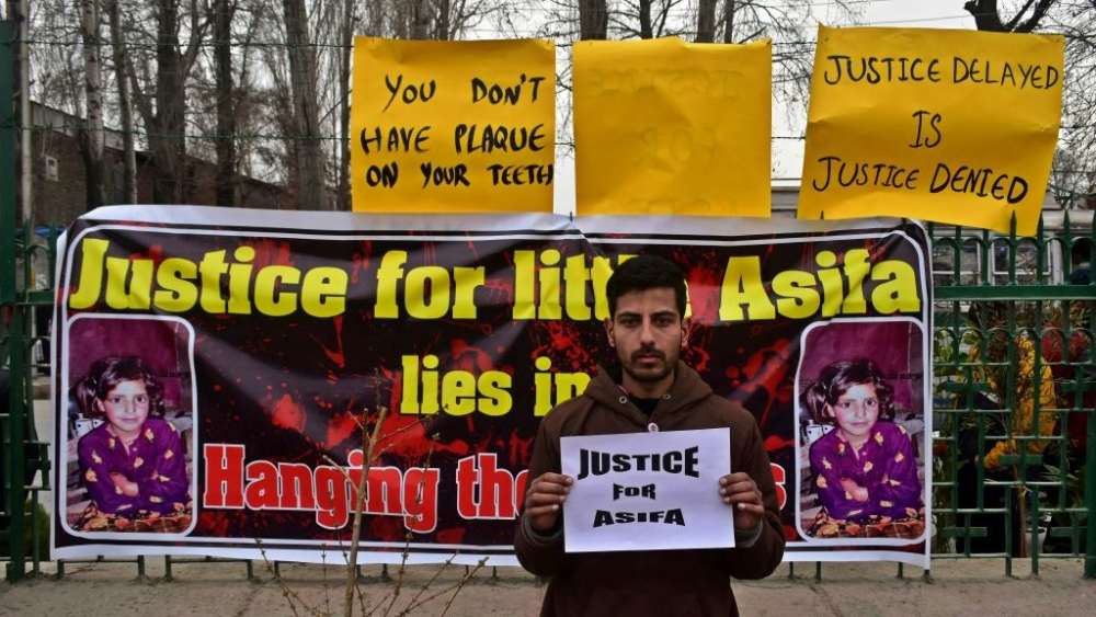 Kashmiri boy takes part in a protest demanding capital punishment for the accused involved in rape and murder of 8-year-old Asifa Bano in Jammu's Kathua district