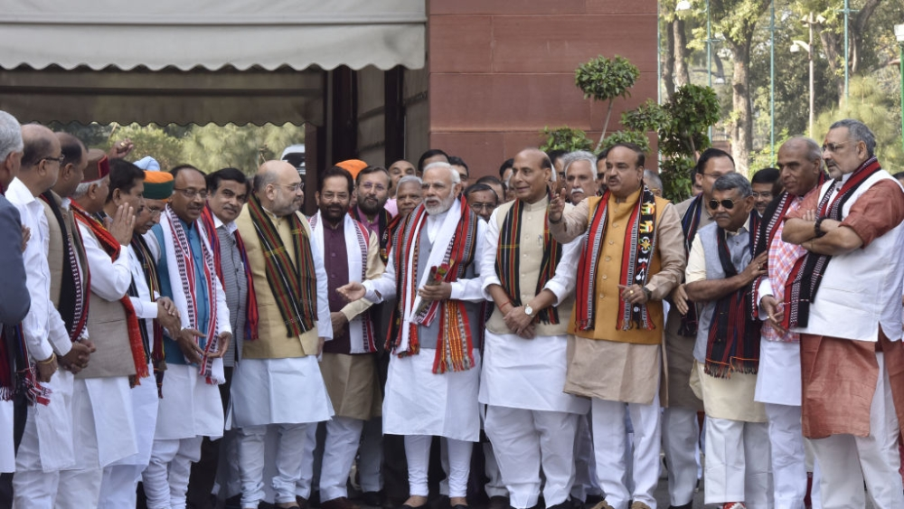 Prime Minister Narendra Modi with other cabinet ministers pose for a photograph outside Parliament after their victory in the assembly elections in North-East