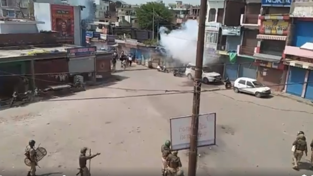 Police firing tear-gas shells on protesters at Nowshera market in Rajouri district of Jammu and Kashmir on Saturday