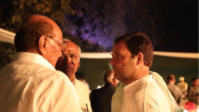 NCP President Sharad Pawar (left) speaks with Leader of Congress in Lok Sabha Mallikarjun Kharge (centre) and Congress President Rahul Gandhi at Sonia Gandhi's dinner at her residence 10 Janpath in Delhi