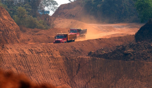 A view of trucks moving amid mine fields near an iron plant at Navelim in Goa. BJP Goa MPs met the party's national president Amit Shah in the New Delhi on Tuesday and discussed the Supreme Court-imposed mining ban in Goa which is slated to come into effect from March 15.