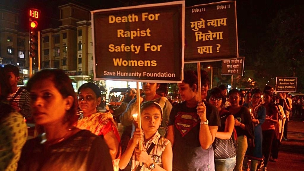 Women and girls undertake a candle light march to demand justice for Kathua and Unnao rape case victims in Navi Mumbai on April 18. Representative image
