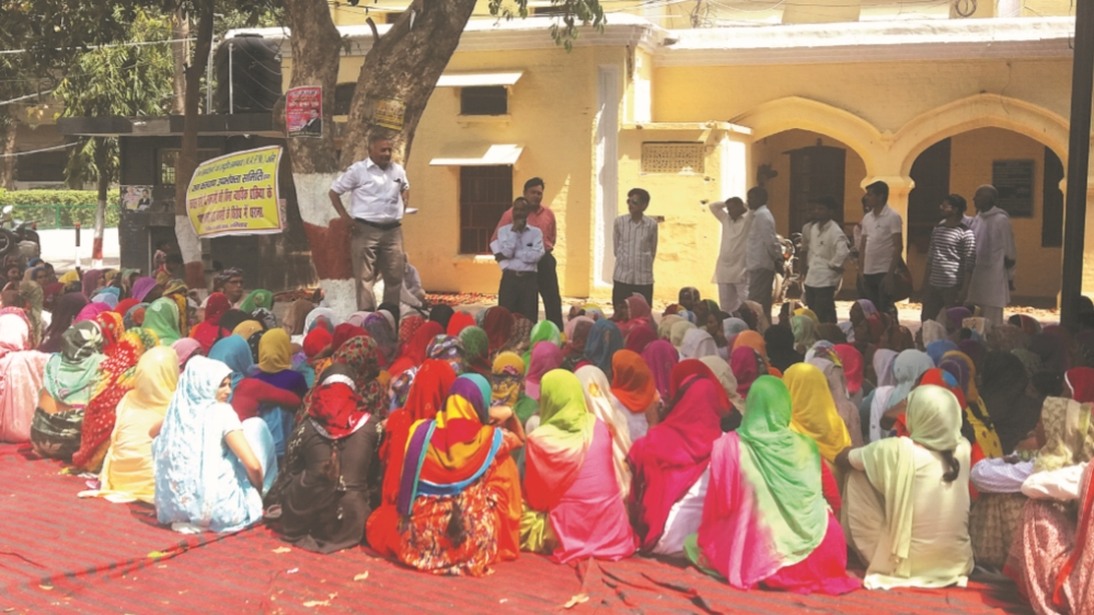 In Muzaffarnagar, Hindu women protest the encounter killings. There are no Muslims because protests by victims' family members might make the situation worse