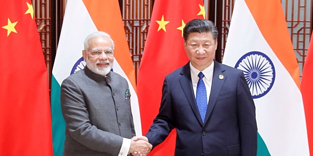 Chinese President Xi Jinping with Indian Prime Minister Narendra Modi at the 9th BRICS summit in Xiamen, China, on September 5, 2017