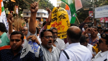 File photo of Congress activists protesting  with a broom on the cancellation of extension date of filing the nomination for panchayat polls in front of State Election Commission office on April 10, 2018 in Kolkata, West Bengal