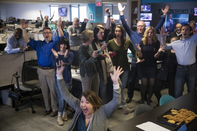 "Cincinnati Enquirer reporter Amber Hunt, foreground, and other Enquirer staff celebrate. in Cincinnati, as they learn the newspaper won the Pulitzer Prize for Local Reporting for ""Seven Days of Heroin,"" a week-long examination of the many ways the heroin crisis is impacting their community."