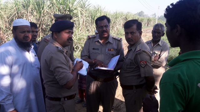 A UP Police team investigating at the spot where the Dalit woman was harassed who later committed suicide