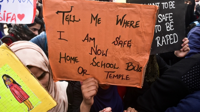 A  student holds a placard during a rally to protest the rape and murder of an eight-year-old girl in J&K's Kathua