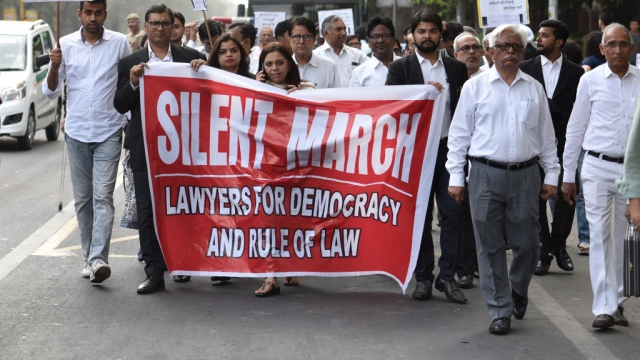 Lawyers in Delhi take out a silent march to Bar Council of India on April 13, 2018 in New Delhi to demand action against the guilty lawyers of Jammu, who came in support of the culprits accused of raping and murdering an eight-year-old child in Kathua. Representative image