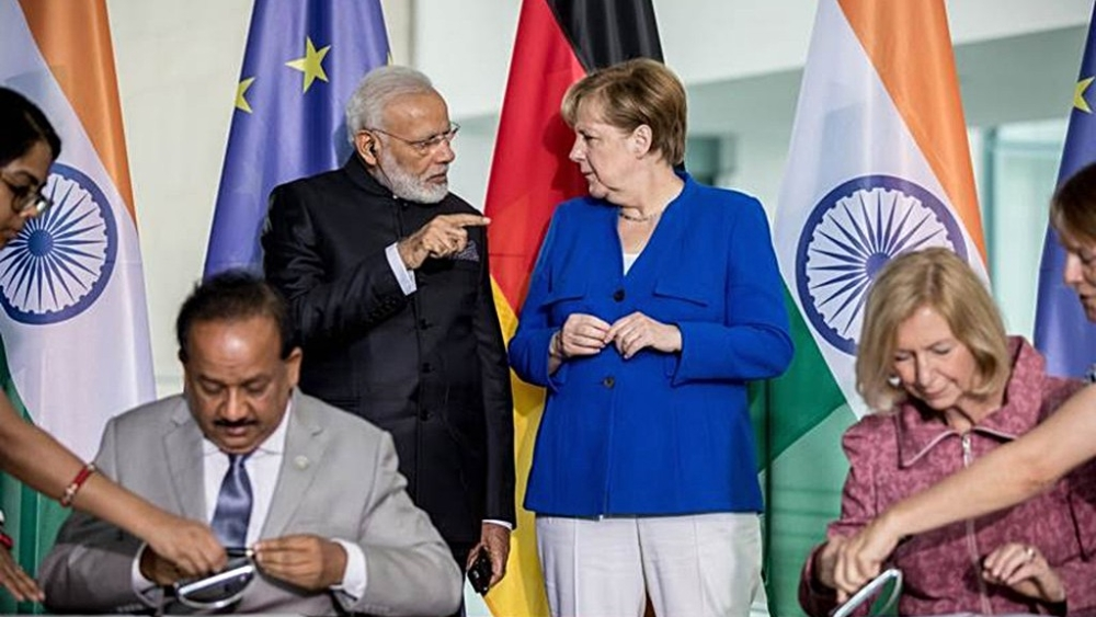 German Chancellor Angela Merkel (standing, right) and Indian Prime Minister Narendra Modi speak during the fourth biennial German-Indian Inter-Governmental Consultations in Berlin in May , 2017 (file photo)