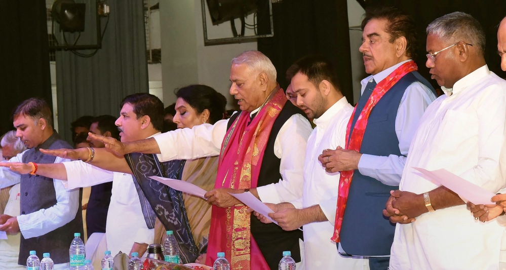 Former Union Finance Minister Yashwant Sinha with party MP Shatrughan Sinha, RJD leader and former Deputy Chief Minister of Bihar Tejaswi Yadav and Congress leader Renuka Chowdhary take oath during 'Rashtra Manch' meeting at Shri Krishna Memorial Hall in Patna