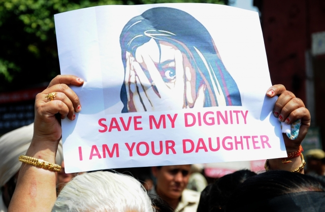 "A protester staging demonstration against incidents of rape in Unnao (Uttar Pradesh) and Kathua (Jammu and Kashmir) displays a poster saying ""Save my dignity, I am your daughter"" in Amritsar,"