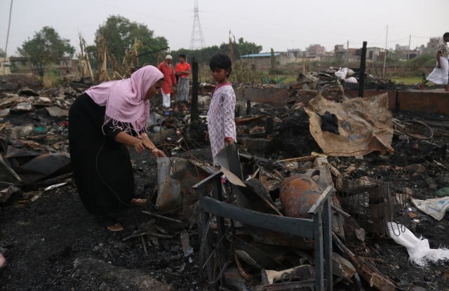 A view of gutted Rohingya refugee camp in southeast Delhi's Kalindi Kunj area after fire broke out in the early hours of Sunday. Approximately 230 residents of the camp have lost their shelter and all their valuables, including identity cards and special visas issued by the United Nations. Many have also lost documents related to their properties in Myanmar.