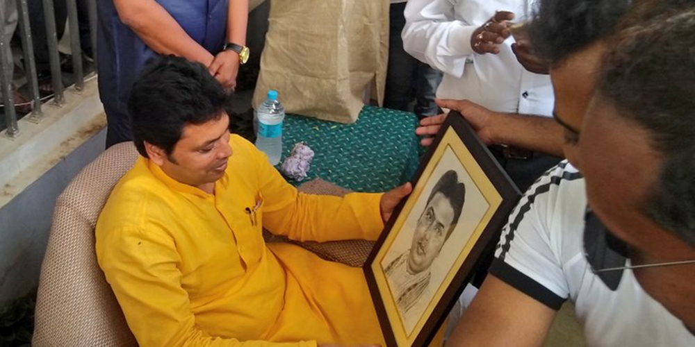 File photo of Tripura's BJP Chief Minister Biplab Deb admiring an image of himself