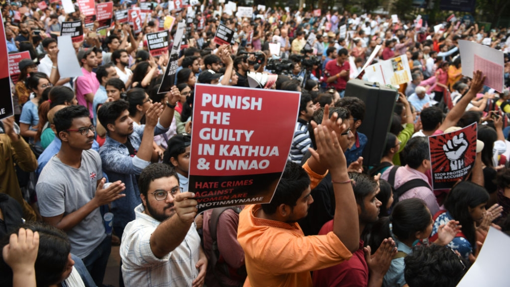 People take part in 'Not In My Name' protest against the Kathua and Unnao rape cases, at Parliament Street in New Delhi, on April 15, 2018