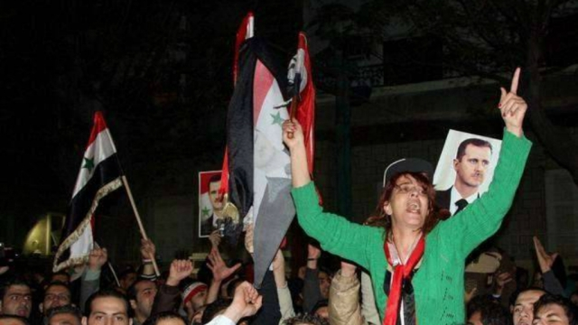 A file photo of supporters of Syrian President Bashar al-Assad staging a demonstration in Damascus