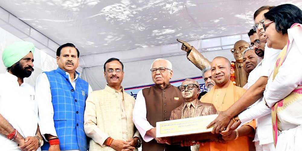 Uttar Pradesh CM Yogi Adityanath receiving Dalit Mitra Samman award on Ambedkar Jayanti