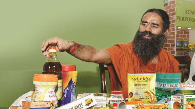 File photo of Baba Ramdev with products from his Patanjali empire