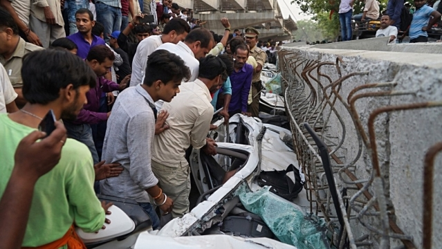 Rescue operations underway at the site where an under-construction flyover collapsed in Varanasi on May 15, 2018. 18 persons were killed and over 50 persons are feared trapped under the debris. Many cars have been buried under the heap of rubble. Flyover was being constructed by the Uttar Pradesh State Bridge Corporation