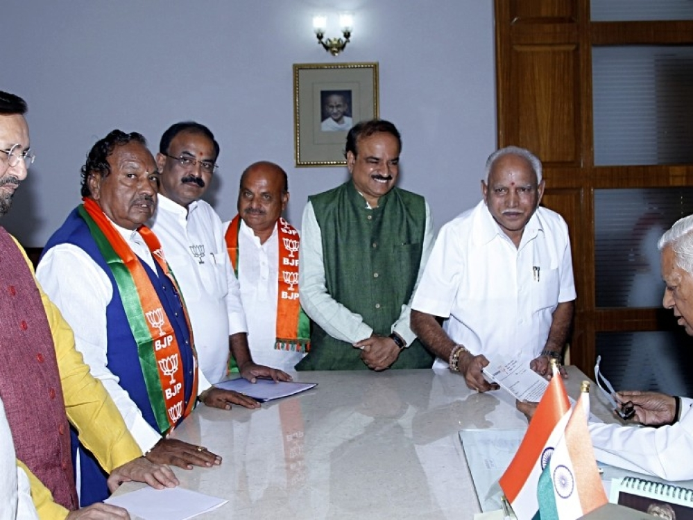 BJP's chief ministerial candidate in Karnataka BS Yeddyurappa (second from right) along with party leaders meets Karnataka Governor Vajubhai Vala (right) to stake claim to form the government in Karnataka, though the party is eight seats short of a majority in the Assembly, in Bengaluru on May 16, 2018