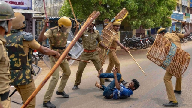 Police beat a protestor demanding closure of Vedanta's Sterlite Copper unit in Thoothukudi (Tuticorin) Tamil Nadu on Wednesday, May 23. One person was killed during the clash, after police's open fire killed at least 10 people on May 22, and injured