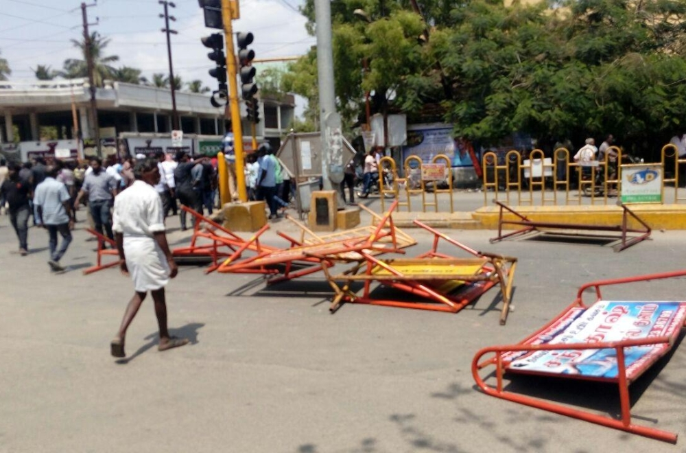 Protesters damage barricades during a demonstration over their demand for the closure of Vedanta's Sterlite copper smelter in Tamil Nadu's Thoothukudi  (Tuticorin) on May 22, 2018