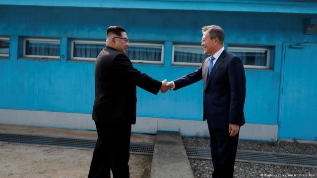 The historic occasion when  North Korean leader Kim Jong Un (left) shook hands with South Korean President Moon Jae In at the line that divides the two Koreas at  Panmunjom on April 27, 2018