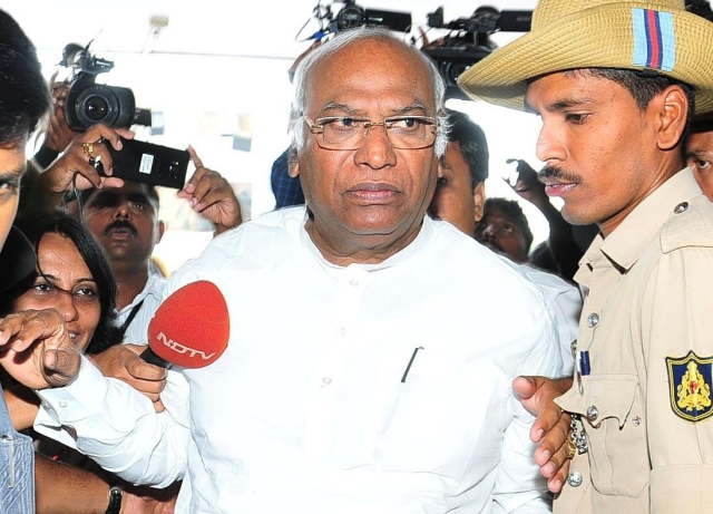 Congress leader Mallikarjun Kharge comes out of Raj Bhavan after attending the legislature party meeting in Bengaluru.