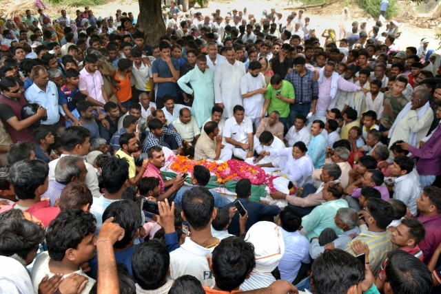 Family members and relatives of Jawan Devendra Singh Baghel, who was killed in a cross-border firing at India- Pakistan border near Hiranagar sector of Kathua, mourn during his funeral at his village Lakhanpur, Uttar Pradesh.