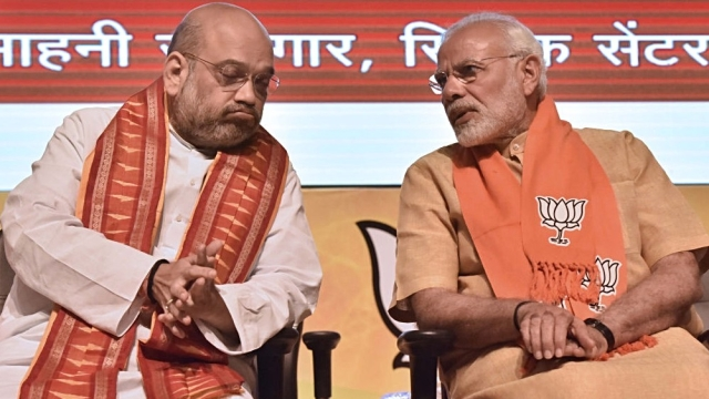 Prime Minister Narendra Modi (right) with BJP National President Amit Shah in New Delhi on May 17, 2018