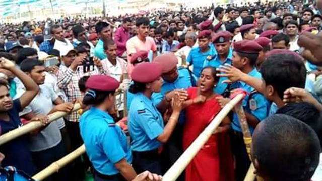 A Madhesi woman being escorted out of PM Modi's rally in Janakpur after raising pro-Madhes slogans during the Indian leader's visit to Nepal last week