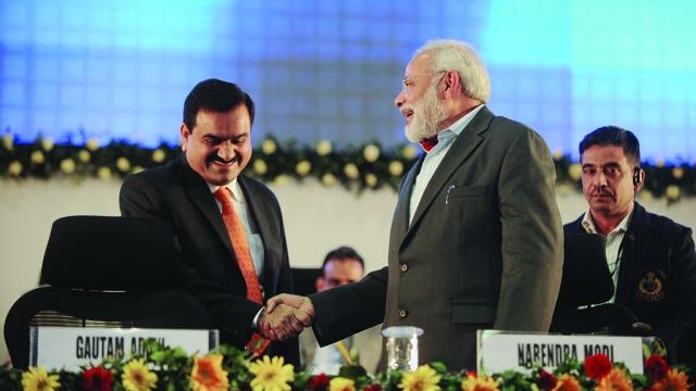 File photo of Prime Minister Narendra Modi with billionaire businessman Gautam Adani