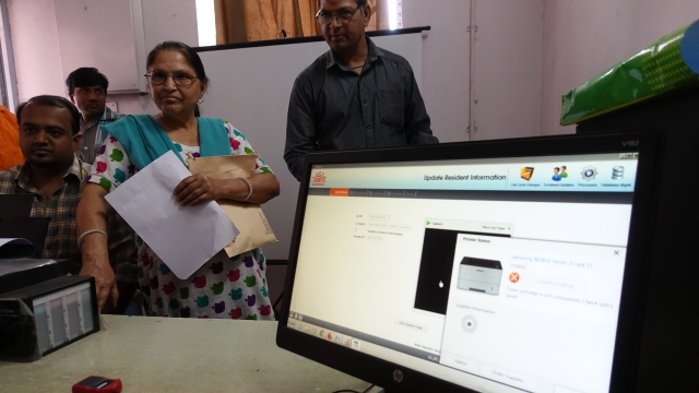 People wait for their turn at Aadhar Enrollment Centre