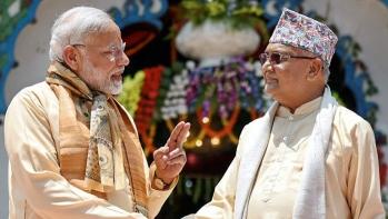 Prime Minister Narendra Modi shakes hands with Nepal Prime Minister Khadga Prasad Oli, during his visit, at Janakpur in  Nepal