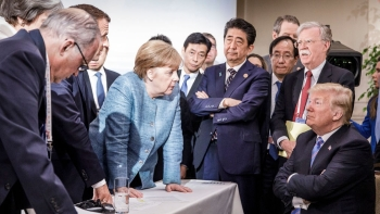 In this photo provided by the German Government Press Office (BPA), German Chancellor Angela Merkel deliberates with US president Donald Trump on the sidelines of the official agenda on the second day of the G7 summit on June 9, 2018 in Charlevoix, Canada. Also pictured are UK prime minister Theresa May, French president Emmanuel Macron, Angela Merkel, Japan prime minister Shinzo Abe and Donald Trump
