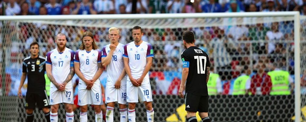 Iceland players take protective action as Argentina's Lionel Messi prepares to take a free kick during the 2018 FIFA World Cup Russia group D match between Argentina and Iceland at Spartak Stadium on June 16, 2018 in Moscow, Russia. Representative image
