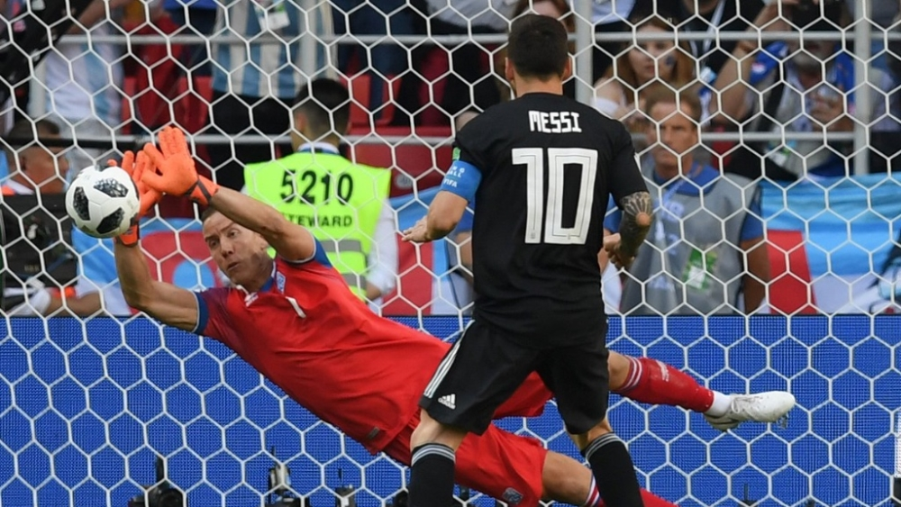 Iceland goalie Halldorsson saves Lionel Messi's shot from the penalty spot