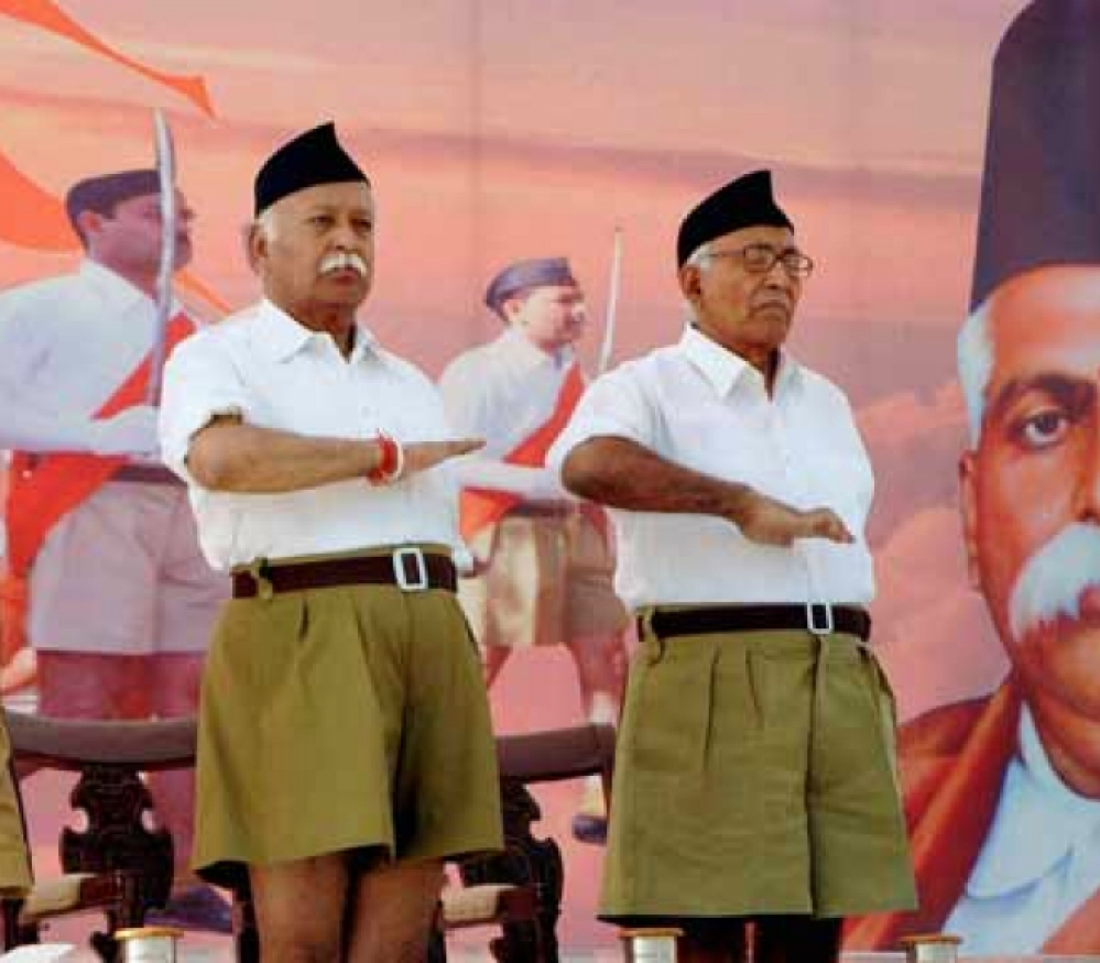RSS chief Mohan Bhagwat (centre) against a backdrop depicting RSS founder KB Hedgewar (file photo)