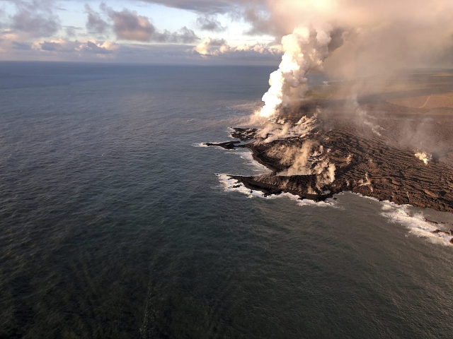 The U.S. Geological Survey shows where lava from Kilauea Volcano is entering the ocean and the resulting laze plume where lava is entering the sea at Kapoho on the island of Hawaii at dawn. As of June 12, lava entering the ocean had added about 100 hectares (250 acres) of new land to the Island of Hawaii.USGS image taken.
