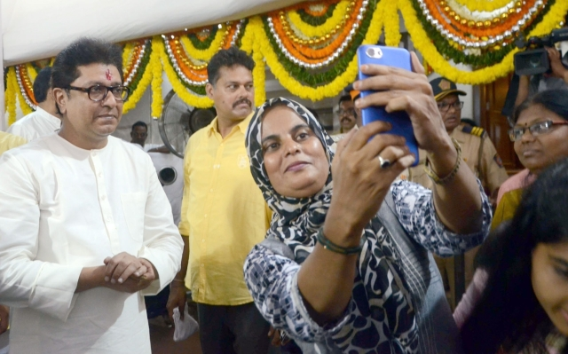 A party worker clicks a selfie with Maharashtra Navnirman Sena (MNS) President Raj Thackeray during his birthday celebrations at his residence in Dadar, Mumbai.