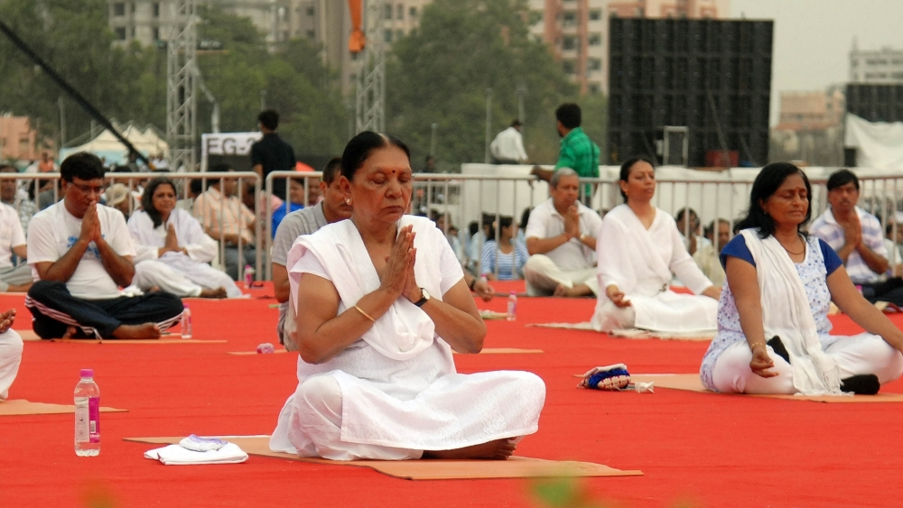 Then Gujarat Chief Minister Anandiben Patel practices yoga on International Day of Yoga in Ahmedabad on June 21, 2016