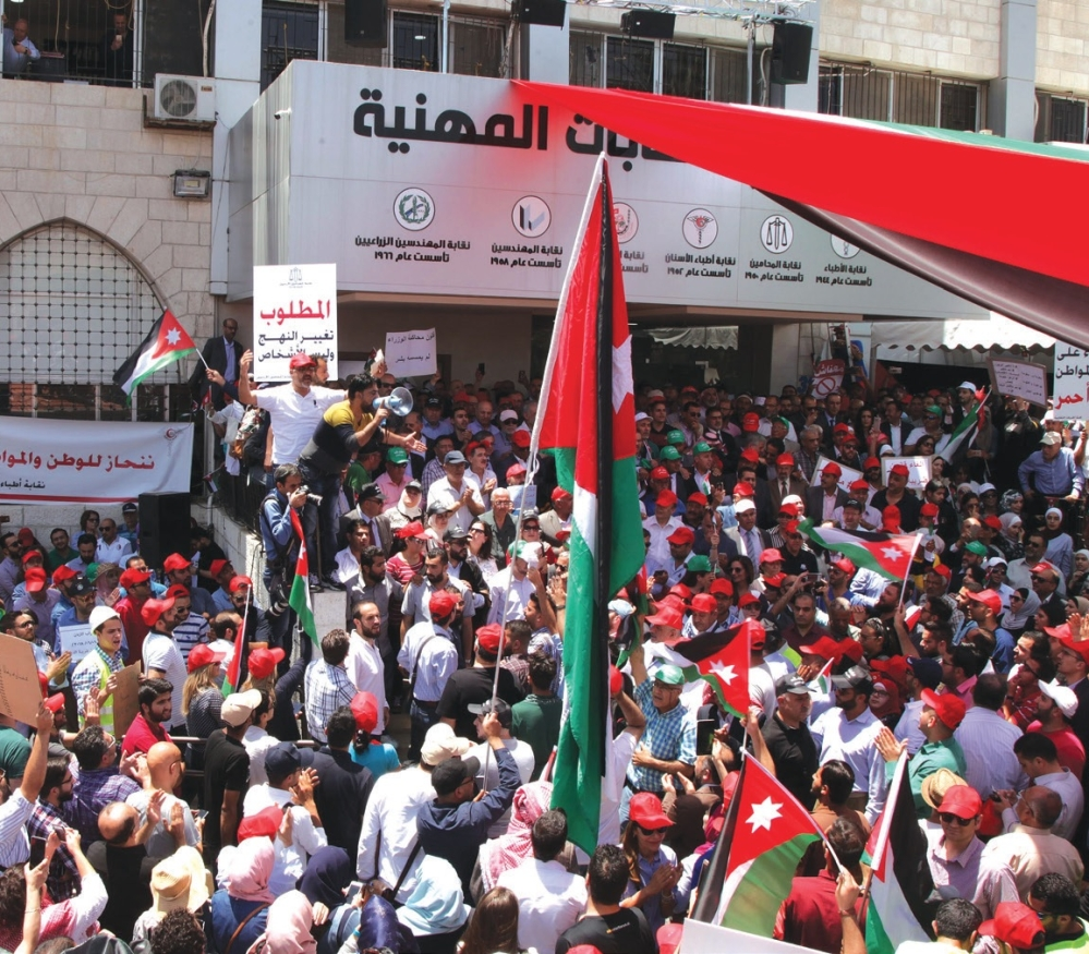Hundreds of Jordanians gather to protest against a controversial income tax bill, amid chants fordissolving parliament in Amman, Jordan on June 6, 2018
