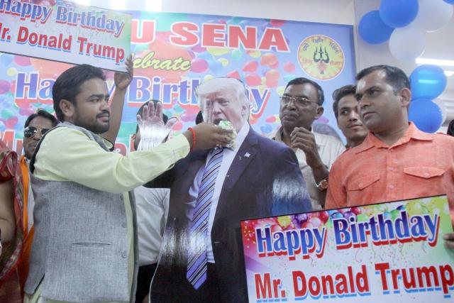 Hindu Sena activists celebrate the birthday of US President Donald Trump, in New Delhi.